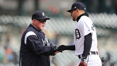 Detroit Tigers manager Ron Gardenhire greets right fielder Nicholas Castellanos after a baseball game against the Kansas City Royals, Monday, April 2, 2018, in Detroit. Detroit won 6-1. (AP Photo/Carlos Osorio)