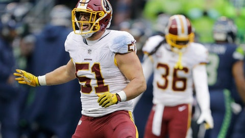 Washington Redskins inside linebacker Will Compton celebrates after he intercepted a pass in the second half of an NFL football game against the Seattle Seahawks, Sunday, Nov. 5, 2017, in Seattle. (AP Photo/Stephen Brashear)