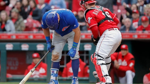 Chicago Cubs' Kyle Schwarber, left, reacts alongside Cincinnati Reds catcher Tucker Barnhart (16) after striking out against relief pitcher Raisel Iglesias in the ninth inning of a baseball game, Monday, April 2, 2018, in Cincinnati. (AP Photo/John Minchillo)