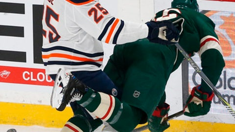 Minnesota Wild's Eric Staal, right, gets tangled up with Edmonton Oilers' Darnell Nurse in the first period of an NHL hockey game Monday, April 2, 2018, in St. Paul, Minn. (AP Photo/Jim Mone)