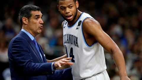 Villanova head coach Jay Wright, left, talks with forward Omari Spellman during the first half against Michigan in the championship game of the Final Four NCAA college basketball tournament, Monday, April 2, 2018, in San Antonio. (AP Photo/David J. Phillip)
