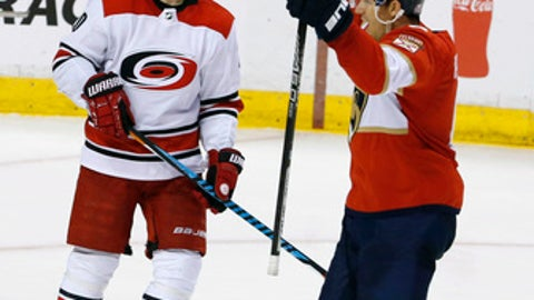 Florida Panthers defenseman Alexander Petrovic (6) celebrates his game-winning goal in the third period in front of Carolina Hurricanes right wing Sebastian Aho (20) during an NHL hockey game, Monday, April 2, 2018, in Sunrise, Fla. The Panthers won the game 3-2. (AP Photo/Joe Skipper)