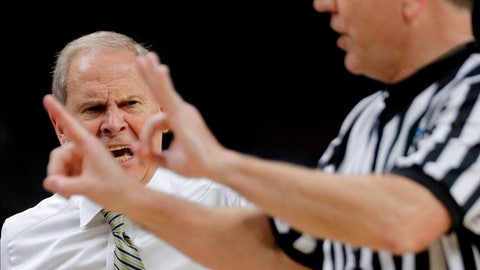 Michigan head coach John Beilein, left, reacts to a call against his team during the second half against Villanova in the championship game of the Final Four NCAA college basketball tournament, Monday, April 2, 2018, in San Antonio. (AP Photo/David J. Phillip)