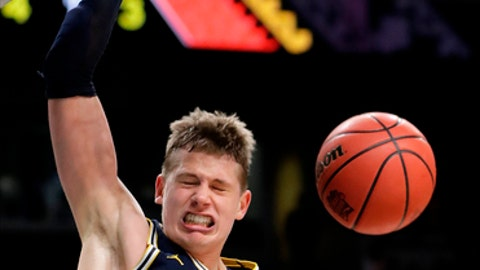 Michigan's Moritz Wagner (13) dunks during the second half in the championship game of the Final Four NCAA college basketball tournament against Villanova, Monday, April 2, 2018, in San Antonio. (AP Photo/Eric Gay)