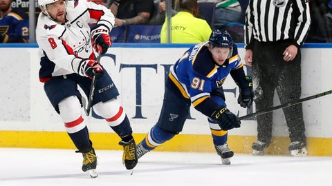 Washington Capitals' Alex Ovechkin (8) scores an empty net goal past St. Louis Blues' Vladimir Tarasenko, of Russia, during the third period of an NHL hockey game Monday, April 2, 2018, in St. Louis. The Capitals won 4-2. (AP Photo/Jeff Roberson)