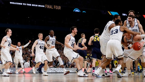 Villanova players celebrate after the championship game of the Final Four NCAA college basketball tournament against Michigan, Monday, April 2, 2018, in San Antonio. Villanova won 79-62. (AP Photo/David J. Phillip)
