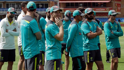 Australia's captain Tim Paine, centre, stands with teammates, during the post match presentation on the fifth day of the final cricket test match between South Africa and Australia at the Wanderers stadium in Johannesburg, South Africa, Tuesday, April 3, 2018. South Africa beat Australia by 492 runs to win the series. (AP Photo/Themba Hadebe)