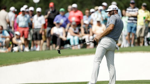 Dustin Johnson watches his putt on the 16th hole during practice for the Masters golf tournament at Augusta National Golf Club, Tuesday, April 3, 2018, in Augusta, Ga. (AP Photo/Matt Slocum)