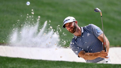 Dustin Johnson blasts from a bunker to the 18th green during a practice round for the Masters golf tournament at Augusta National Golf Club in Augusta, Ga., Tuesday, April 3, 2018. (Curtis Compton/Atlanta Journal-Constitution via AP)