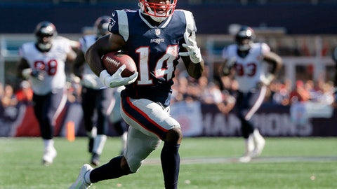 FILE - In this Sept. 24, 2017, file photo, New England Patriots wide receiver Brandin Cooks runs toward the goal line for a touchdown after catching a pass from Tom Brady during the second half of an NFL football game against the Houston Texans in Foxborough, Mass. The Patriots have traded Cooks to the Rams for Los Angeles first-round draft pick, 23rd overall. In the deal Tuesday, April 3, 2018, New England also sends a fourth-round choice to the Rams, who give the Patriots a sixth-rounder. (AP Photo/Steven Senne, File)