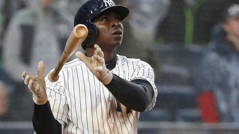 New York Yankees' Didi Gregorius drops the bat as he watches his three-run home run, his second of the day, in the seventh inning of the team's baseball game against the Tampa Bay Rays at Yankee Stadium in New York, Tuesday, April 3, 2018. (AP Photo/Kathy Willens)