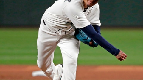 FILE - In this Thursday, March 29, 2018, file photo, Seattle Mariners starting pitcher Felix Hernandez throws to a Cleveland Indians batter during the fifth inning of a baseball game in Seattle. Hernandez tries to follow an encouraging season opener when Seattle plays at San Francisco on Wednesday, April 4. (AP Photo/Elaine Thompson, File)