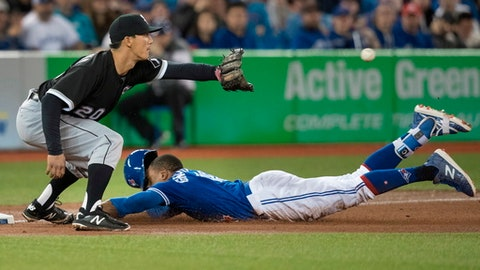 Toronto Blue Jays' Curtis Granderson slides safely into third with a triple as Chicago White Sox third baseman Tyler Saladino waits for the throw during the fourth inning of a baseball game Tuesday, April 3, 2018, in Toronto. (Fred Thornhill/The Canadian Press via AP)