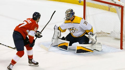 Florida Panthers center Derek Mac Kenzie misses as Nashville Predators goaltender Pekka Rinne defends in the second period in an NHL hockey game Tuesday