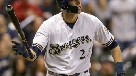 Milwaukee Brewers' Christian Yelich watches his game tying solo home run off of St. Louis Cardinals' Dominic Leon during the ninth inning of a baseball game Tuesday, April 3, 2018, in Milwaukee. (AP Photo/Tom Lynn)