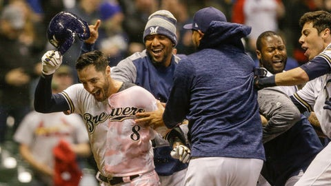 Milwaukee Brewers' Ryan Braun is doused with Gatorade after his walk off home run against St. Louis Cardinals' Dominic Leon during the ninth inning of a baseball game Tuesday, April 3, 2018, in Milwaukee. (AP Photo/Tom Lynn)