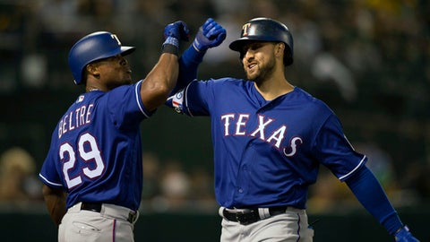 Texas Rangers third baseman Adrian Beltre (29) congratulates teammate Joey Gallo on his solo home run off Oakland Athletics starting pitcher Kendall Graveman during the third inning of a baseball game Tuesday, April 3, 2018, in Oakland, Calif. (AP Photo/D. Ross Cameron)