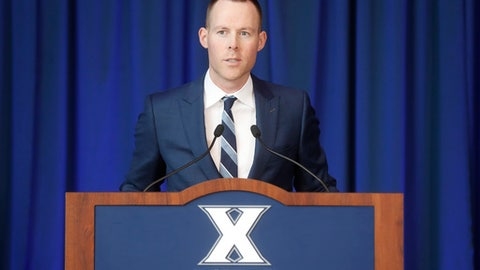 Xavier men's basketball head coach Travis Steele speaks during a news conference at the Cintas Center, Wednesday, April 4, 2018, in Cincinnati. Xavier stuck to custom and promoted from within to replace coach Chris Mack, hiring top assistant Travis Steele on Saturday as its 18th head coach. The move came four days after Mack  a former Musketeer player who is the winningest coach in school history  left to coach Louisville. The 36-year-old Steele has been an assistant at Xavier for 10 seasons, including the last nine under Mack.(AP Photo/John Minchillo)