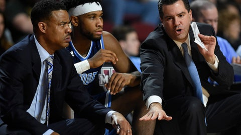 Rhode Island assistant coach Tom Moore, right, talks with associate head coach David Cox, left, during an NCAA college basketball game, Tuesday, Jan. 30, 2018, in Amherst, Mass (AP Photo/Jessica Hill)