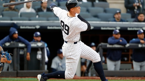 New York Yankees' Aaron Judge follows through on a two-run home run in the fourth inning of a baseball game against the Tampa Bay Rays at Yankee Stadium in New York, Wednesday, April 4, 2018. (AP Photo/Kathy Willens)