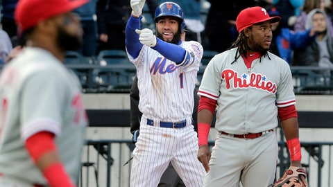 New York Mets' Amed Rosario, center, reacts after hitting a two-run triple during the sixth inning of the baseball game against the Philadelphia Phillies at Citi Field, Wednesday, April 4, 2018, in New York. (AP Photo/Seth Wenig)