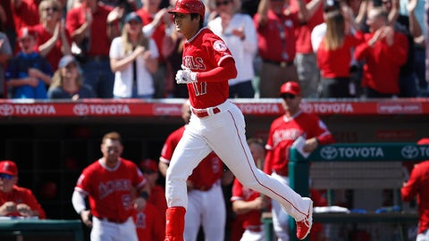 Los Angeles Angels' Shohei Ohtani, of Japan, heads home after hitting a two-run home run in the fifth inning of a baseball game against the Cleveland Indians, Wednesday, April 4, 2018, in Anaheim, Calif. (AP Photo/Jae C. Hong)