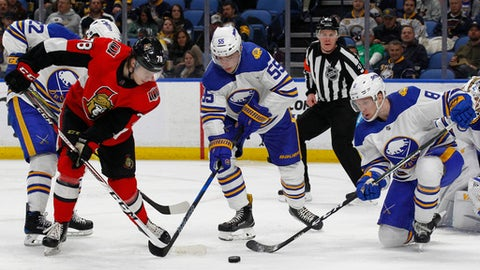 Buffalo Sabres defenseman Rasmus Ristolainen (55) and Casey Nelson (8) compete against Ottawa Senators forward Filip Chlapik (78) for the puck during the second period of an NHL hockey game Wednesday, April 4, 2018, in Buffalo, N.Y. (AP Photo/Jeffrey T. Barnes)