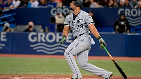 Chicago White Sox's Jose Abreu watches his solo home run against the Toronto Blue Jays during the eighth inning of a baseball game Wednesday, April 4, 2018, in Toronto. (Nathan Denette/The Canadian Press via AP)