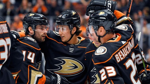 Anaheim Ducks center Adam Henrique, left, celebrates his goal with defensemen Brandon Montour, center, and Francois Beauchemin during the second period of an NHL hockey game against the Minnesota Wild on Wednesday, April 4, 2018, in Anaheim, Calif. (AP Photo/Mark J. Terrill)