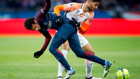 FILE - In this Jan.27, 2018 file photo, PSG's Neymar, left challenge with Montpellier's Pedro Felipe Teodosio Mendes during their French League One soccer match between Paris Saint Germain and Montpellier at the Parc des Princes stadium in Paris. With only 26 goals conceded in 31 games, Montpellier has the league's second-best defense behind runaway Paris Saint-Germain and plenty to play for with seven games left this season. (AP Photo/Christophe Ena, File)