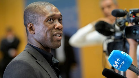 FILE - In this Aug. 30, 2017 file photo, soccer coach Clarence Seedorf arrives at the 19th Elite Club Coaches Forum at the UEFA Headquarters in Nyon, Switzerland. Seedorf is running out of time to save Deportivo La Coruna in the Spanish league. The former Dutch midfielder took over the coaching job at Deportivo with the mission of keeping the traditional Spanish club in the first division. (Jean-Christophe Bott/Keystone via AP, File)