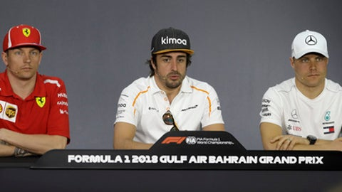 From left, Ferrari driver Kimi Raikkonen of Finland, is flanked by McLaren driver Fernando Alonso of Spain and Mercedes driver Valtteri Bottas of Finland answer reporter questions during a press conference, at the Formula One Bahrain International Circuit in Sakhir, Bahrain, Thursday, April 5, 2018. The Bahrain Formula One Grand Prix will take place here on Sunday. (AP Photo/Luca Bruno)