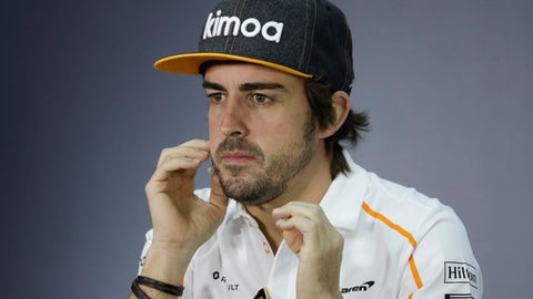 McLaren driver Fernando Alonso of Spain answers reporter questions during a press conference, at the Formula One Bahrain International Circuit in Sakhir, Bahrain, Thursday, April 5, 2018. The Bahrain Formula One Grand Prix will take place here on Sunday. (AP Photo/Luca Bruno)