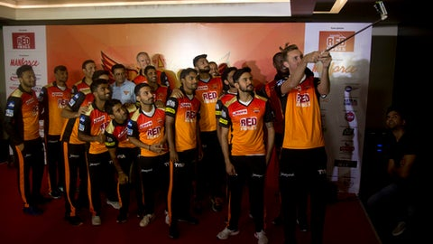 Sunrisers Hyderabad cricket player Alex Hales takes a selfie with team members during the unveiling of the team's new signings in Hyderabad, India, Thursday, April 5, 2018. The VIVO IPL T20 cricket tournament is scheduled to begin on April 7. (AP Photo /Mahesh Kumar A.)