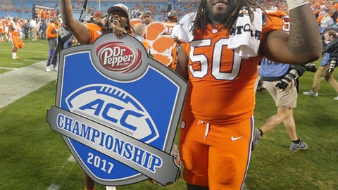 Clemson's Jabril Robinson (50) and Jalen Williams (30) celebrate after their win over Miami in the Atlantic Coast Conference championship NCAA college football game in Charlotte, N.C., Sunday, Dec. 3, 2017. (AP Photo/Bob Leverone)