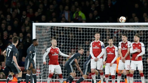 CSKA's Aleksandr Golovin, left, shoots to score his sides opening goal during the Europa League quarterfinal, first leg soccer match between Arsenal and CSKA Moscow at the Emirates stadium in London Thursday, April 5, 2018. (AP Photo/Tim Ireland)