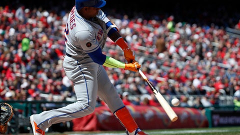 New York Mets' Yoenis Cespedes hits a solo home run during the fourth inning of the home opener baseball game against the Washington Nationals at Nationals Park, Thursday, April 5, 2018, in Washington. (AP Photo/Alex Brandon)