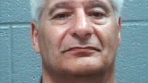 This booking photo provided by the Columbia County Sheriff's Office, shows Steven F. Hoppenbrouwer, who was charged with driving under the influence after the charter bus he was driving to the Masters golf tournament overturned on a Georgia interstate Thursday, April 5, 2018, near Augusta, Ga., injuring 15 people and snarling traffic as scores of fans made the pilgrimage to one of the sport's premier events. (Columbia County Sheriff's Office via AP)