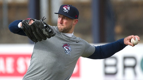 New York Mets outfielder Tim Tebow warms up before his debut with the Binghamton Rumble Ponies minor league baseball team as they host the Portland Sea Dogs, Thursday, April 5, 2018, at NYSEG Stadium in Binghamton, N.Y. (AP Photo/Matt Smith)