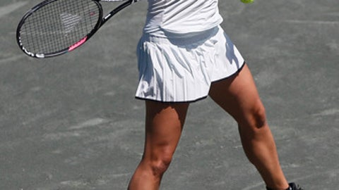 Daria Kasatkina returns the ball against Irina-Camelia Begu during a match, Thursday, April 5, 2018 at the Volvo Car Open tennis tournament in Charleston, S.C. (Andrew Whitaker/The Post And Courier via AP)