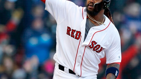 Boston Red Sox designated hitter Hanley Ramirez celebrates after his bases-loaded walkoff single in the twelfth inning of a baseball game against the Tampa Bay Rays at Fenway Park in Boston, Thursday, April 5, 2018. (AP Photo/Charles Krupa)