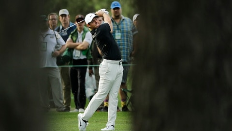 Rory McIlroy, of Northern Ireland, hits a shot on the 17th hole during the first round at the Masters golf tournament Thursday, April 5, 2018, in Augusta, Ga. (AP Photo/David J. Phillip)