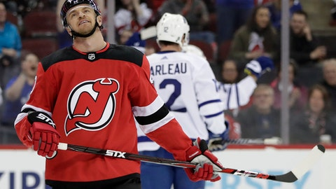 New Jersey Devils right wing Michael Grabner, of Austria, reacts after Toronto Maple Leafs center William Nylander scored a goal during the first period of an NHL hockey game, Thursday, April 5, 2018, in Newark, N.J. (AP Photo/Julio Cortez)