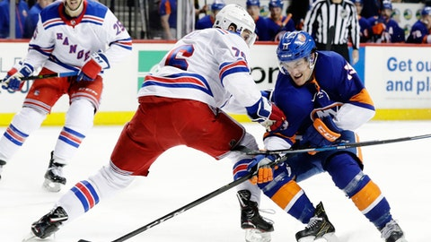 New York Islanders' Mathew Barzal (13) skates past New York Rangers' Brady Skjei (76) during the second period of an NHL hockey game Thursday, April 5, 2018, in New York. (AP Photo/Frank Franklin II)