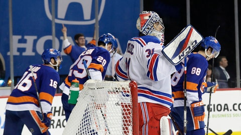 New York Rangers goaltender Ondrej Pavelec (31) reacts as the New York Islanders skate away after Anthony Beauvillier scored a goal during the second period of an NHL hockey game Thursday, April 5, 2018, in New York. (AP Photo/Frank Franklin II)