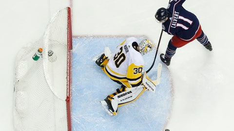 Pittsburgh Penguins' Matt Murray, left, mkes a save against Columbus Blue Jackets' Matt Calvert during the second period of an NHL hockey game Thursday, April 5, 2018, in Columbus, Ohio. (AP Photo/Jay LaPrete)
