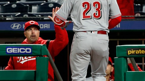Cincinnati Reds' Adam Duvall (23) is greeted by manager Bryan Price after hitting a solo home run off Pittsburgh Pirates relief pitcher George Kontos during the eighth inning of a baseball game in Pittsburgh, Thursday, April 5, 2018. (AP Photo/Gene J. Puskar)