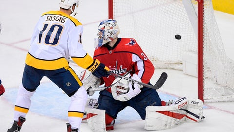 Nashville Predators center Colton Sissons (10) and Washington Capitals goaltender Philipp Grubauer (31), of Germany, watch a goal by Predators defenseman Roman Josi during the third period of an NHL hockey game Thursday, April 5, 2018, in Washington. The Predators won 4-3. (AP Photo/Nick Wass)