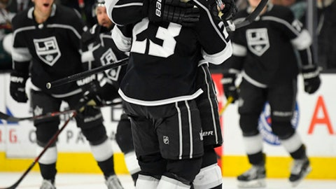 Los Angeles Kings right wing Dustin Brown (23) celebrates his overtime goal with defenseman Drew Doughty in an NHL hockey game against the Minnesota Wild on Thursday, April 5, 2018, in Los Angeles. The Kings won 5-4. (AP Photo/Mark J. Terrill)