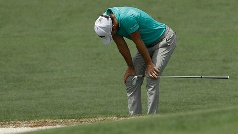 Danny Willett, of England, reacts to a shot on the second hole during the second round at the Masters golf tournament Friday, April 6, 2018, in Augusta, Ga. (AP Photo/Matt Slocum)